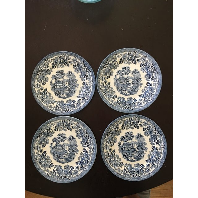 """Set of four 10"""" dinner plates. Made by Churchill in Staffordshire England. Microwave and dishwasher safe. No chips or cracks."""