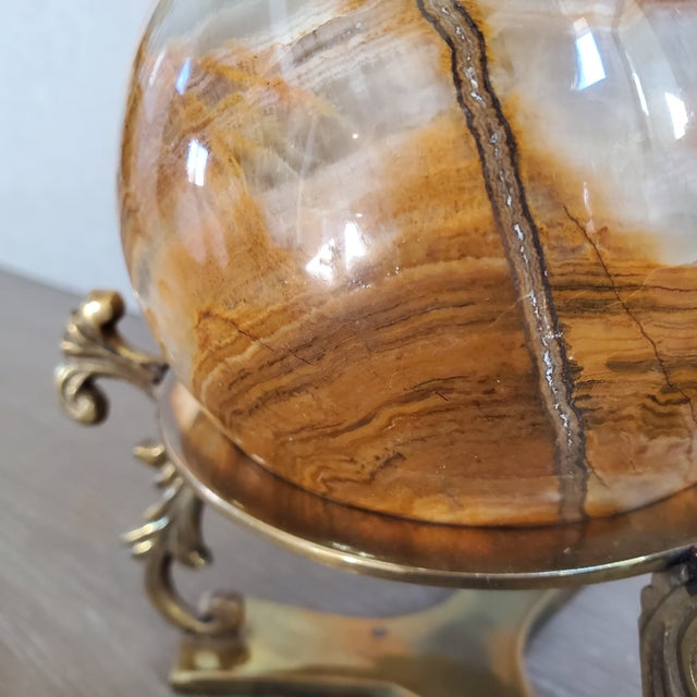 Vintage Italian marble sphere with a polished finish. The sphere comes with a solid brass base. The striations in the...