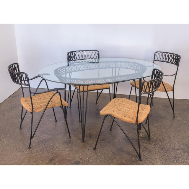 Amazing Italian modern, Maurizio Tempestini patio set for Salterini. Features an ornamental ribbon motif that is lovely to...