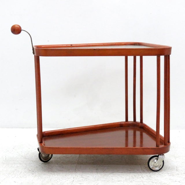 Sculptural two-tier wooden serving cart with textured glass top on three metal casters from Sweden, 1960s, with wooden...