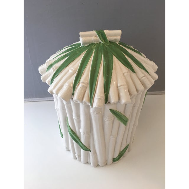 "Glazed ceramic canister with green and white faux-bamboo detail. Removable lid. Marked ""Made in Italy"" as shown."