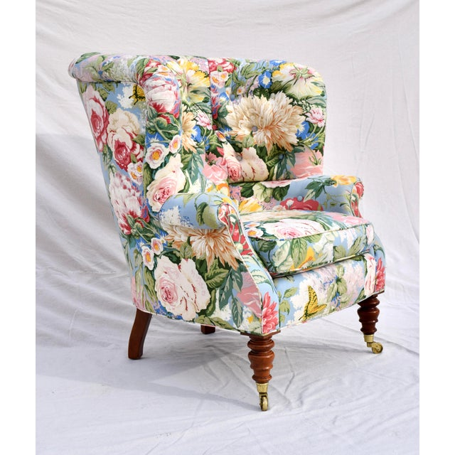 An exceptional cottage chic Baker Furniture Company wingback lounge chair. Features include enveloping, curved & tufted...
