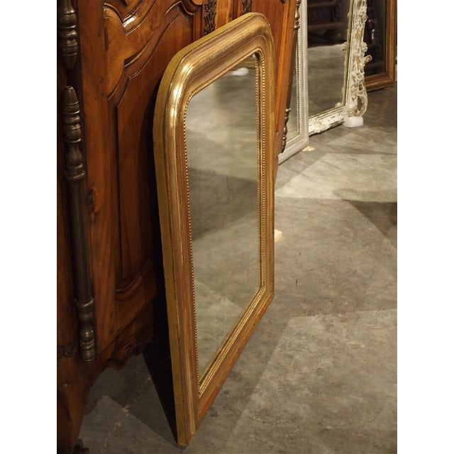 This versatile, clean lined, antique French Louis Philippe mirror is over 100 years old and can be used with almost any...