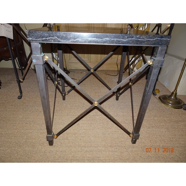 Very heavy one inch slab black marble table with diamond shaped stretchers with brass screws. The marble is attached to...
