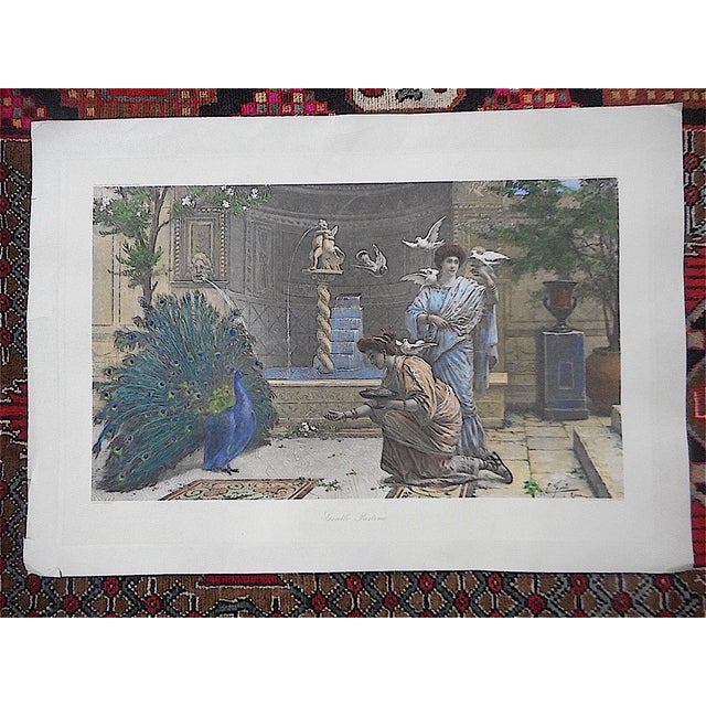 This monumental double elephant folio hand colored lithograph depicts two people feeding a peacock and some other birds. A...