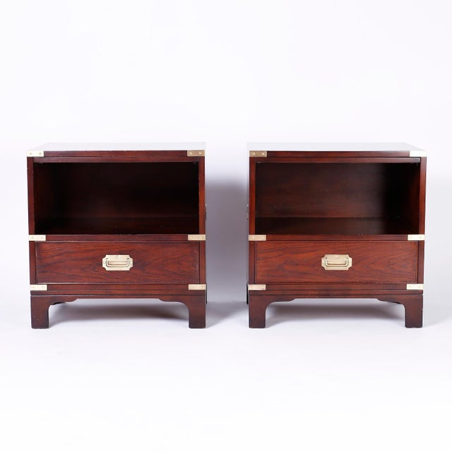 Pair of mahogany nightstands with Campaign style brass hardware, slide out tray, storage space over a drawer and Classic...