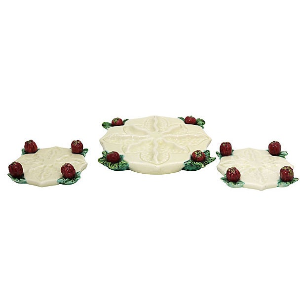 Thirteen piece French majolica table adornments. Figural fruit on each Piece Large trivet, two wine coasters and ten knife...