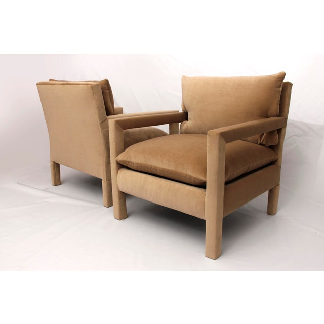 Exceptional pair of 1970's Parson Style Lounge Chairs by Milo Baughman, newly upholstered in camel velvet.