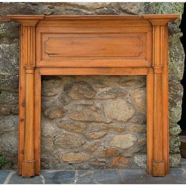 An elegant early 19th century. pine fireplace mantel from the Piedmont region of Virginia. The gracefully scalloped shelf...