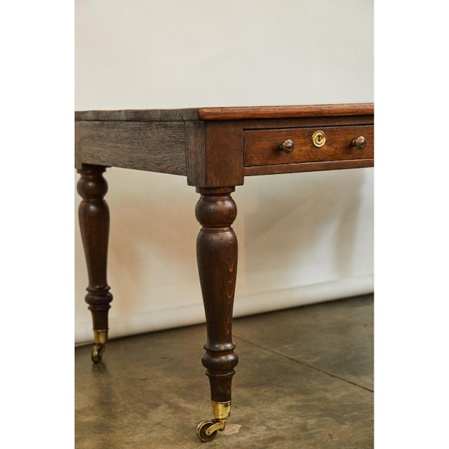 This Writing Table/Desk was originally used at Oxford University. This table has a newly crafted intricately inlaid top....