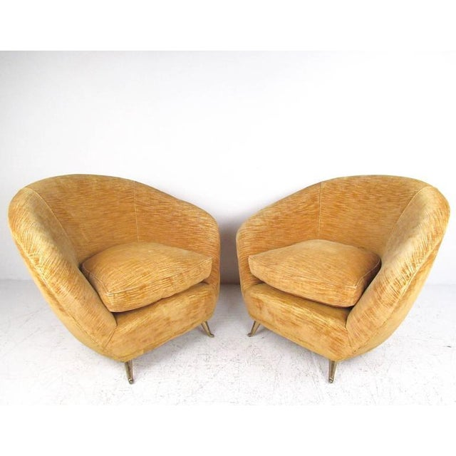 This unique pair of stylish sculptural lounge chairs feature Mid-Century Italian design in plush velvet upholstery. Angled...