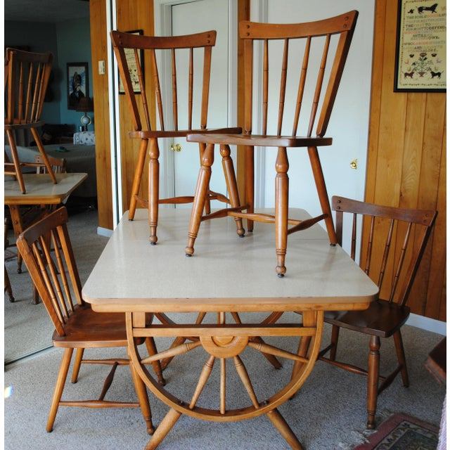 1950's Ethan Allen Wagon Wheel Table and 4 chairs Made in Vermont by Baumritter Solid Maple Laminate top, one extra leaf...