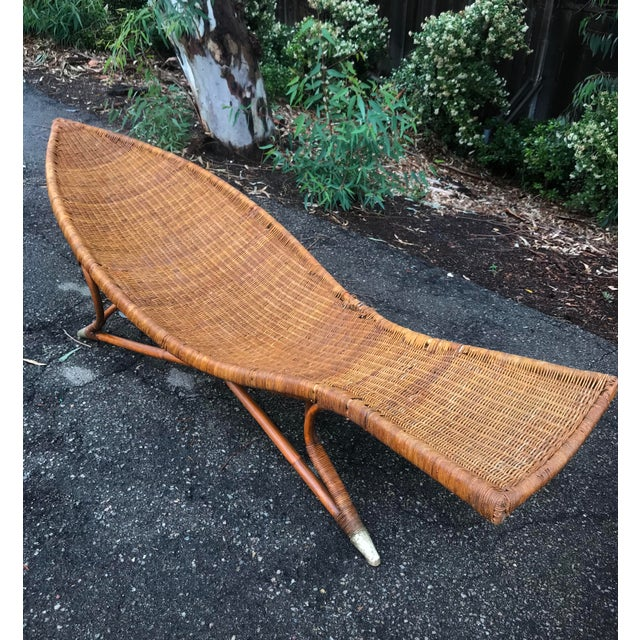 From artist Lina Zervudachi for Elsa Schiaparelli. Rattan/handwoven wicker fish-shaped large lounge. Sculptural and...
