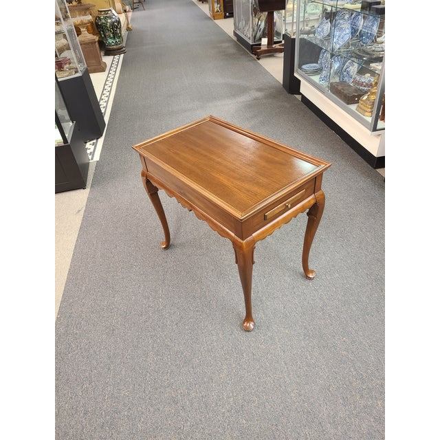 Vintage Ethan Allen Queen Anne mahogany tea table from their Georgian Court Collection, featuring pull outs on both sides...