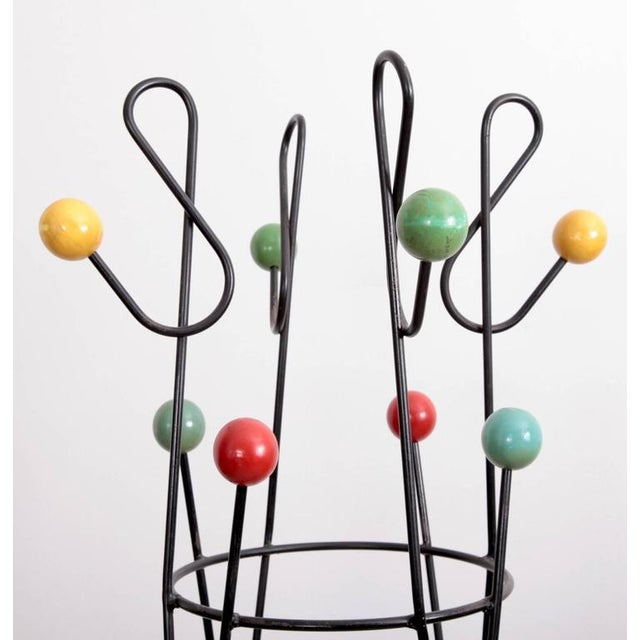 Coat rack by Roger Feraud for GEO. Black iron. The piece is in excellent condition and very heavy.