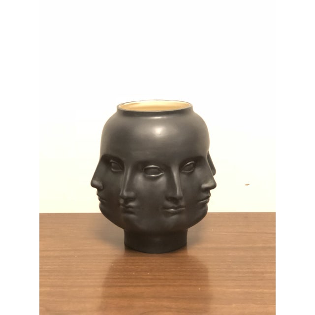 Handmade ceramic matte black perpetual face vase. Can be used for decor or as plant or vessel for flowers. Similar in...