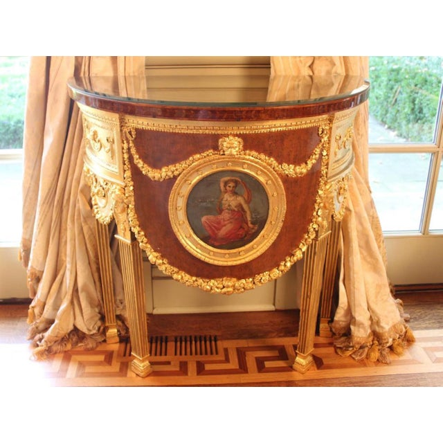 """Mahogany and Sycamore with gold leaf decoration and painted medallion. 32""""W. x 16""""D. x 26""""H. Crackle to the wood veneer on..."""