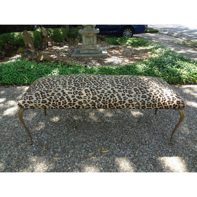 Stunning Italian Gio Ponti style brass or bronze bench professionally upholstered in Italian leopard print hair hide,...