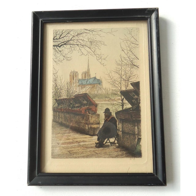 An antique engraving with selective hand tinting, subject is a bookseller on the Seine. A small charming piece! No...