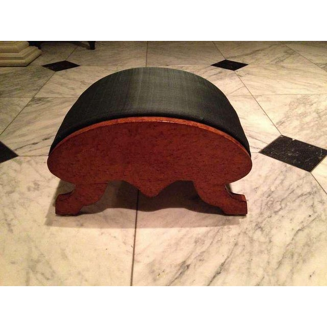 A Biedermeier footstool with a pleasing Silhouette and beautifully grained wood, newly upholstered in bottle-green dyed...