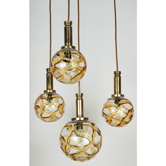 Organic globe fixture by Doria Lighting co. The polished brass fixture supports 2 different size organic style globes of...