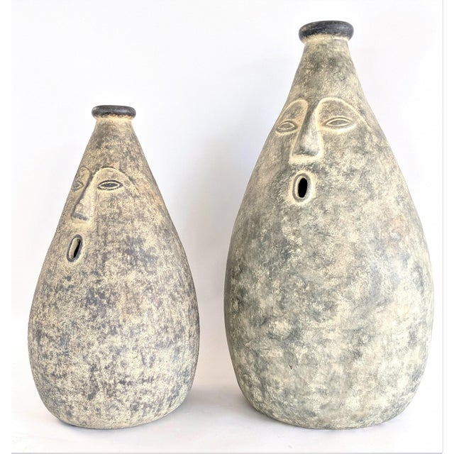 Large and whimsical vessels / vases. Very heavy. Mouths on both are open. Sold as a pair. No Maker's marks. Measurements:...