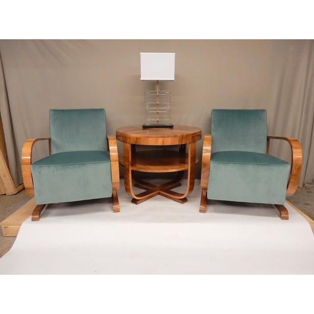 Pair of Northern European Art Deco upholstered armchairs with walnut frame. They are very comfortable. They have been...