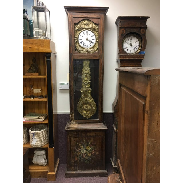 The Antique French Grandfather clock is from 1830-1860. It features a floral arrangement hand pained not he lower front...