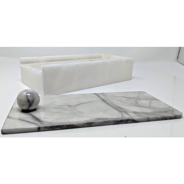 Crafted of naturally stunning alabaster, this decorative box lends the console or vanity a note of organic elegance....