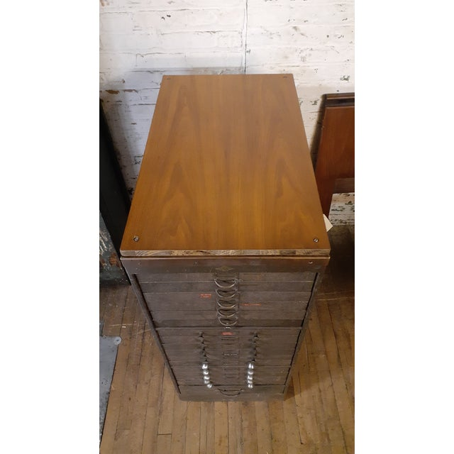 A gorgeous industrial piece from Browne Morse of Muskegon, MI. Wood topped 17 drawer cabinet. Completely intact and...