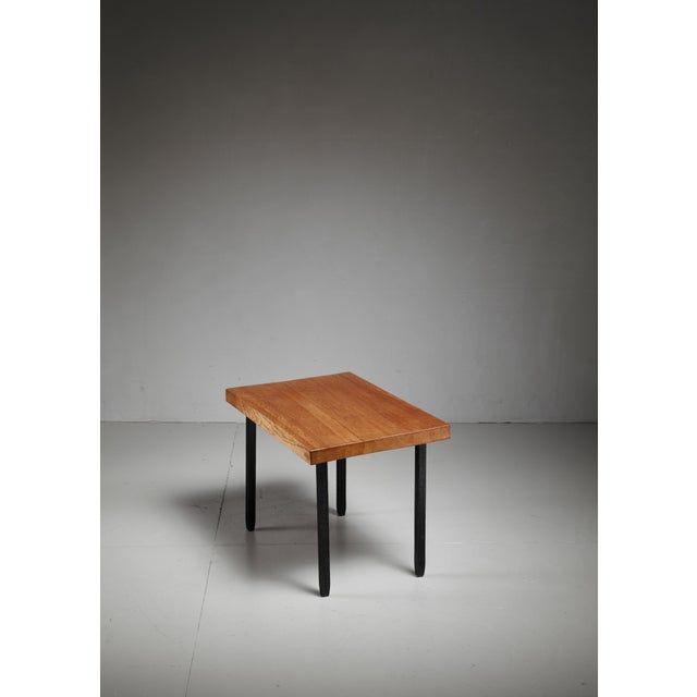 A small oak sidetable on iron legs by Jean Touret for Atelier Marolles. Jean Touret (1916-2004) began a career as a...