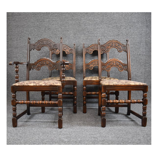 Set consists of Five side chairs and One armchair (slight variation in coloring). Set features uniquely carved backs,...