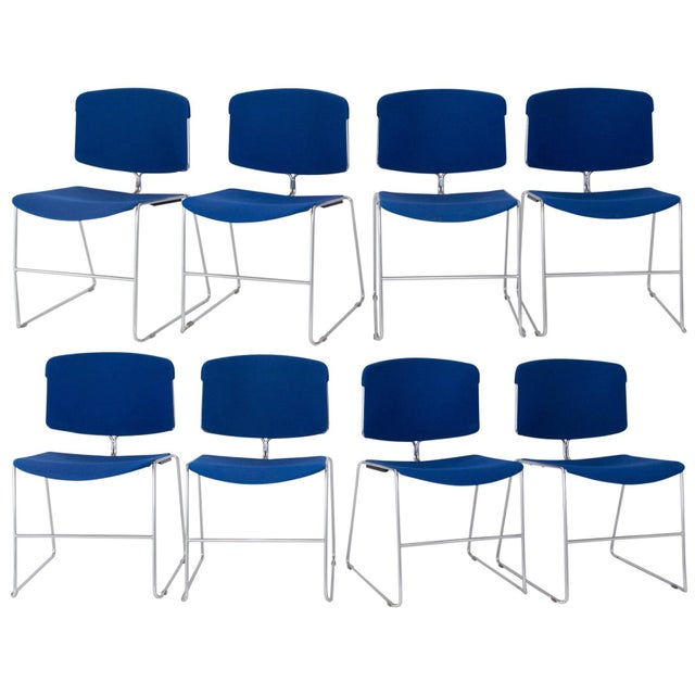 Set of eight Steelcase Max-Stacker chairs, dated 1983. Original blue fabric-covered seats and backs with polished chrome...