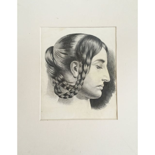 An original French master portrait of a woman wearing braids from a portfolio of drawings dated 1847. Displayed in a...