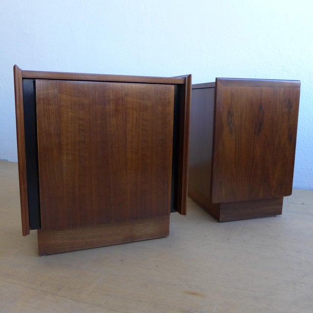 This is a beautiful pair of walnut nightstands by Dillingham. The walnut nightstands feature a cabinet door that opens to...