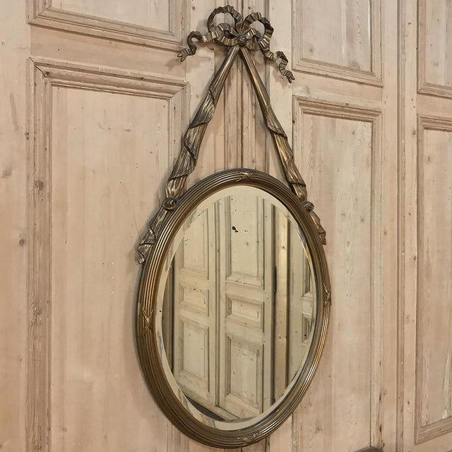 Antique French Louis XVI Gilded Mirror is an interesting design, rendered from hand-carved wood and showing its original...