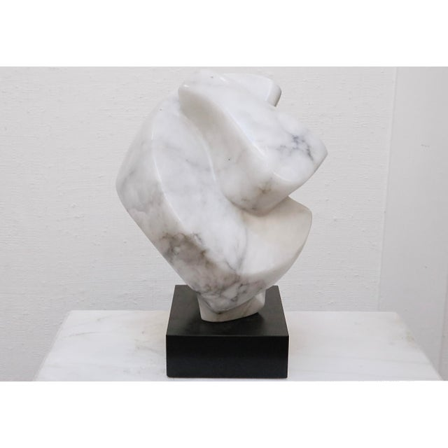 A fabulous contemporary sculpture made of solid alabaster. Gentle angled curves inspire perhaps a closed fist or a large...