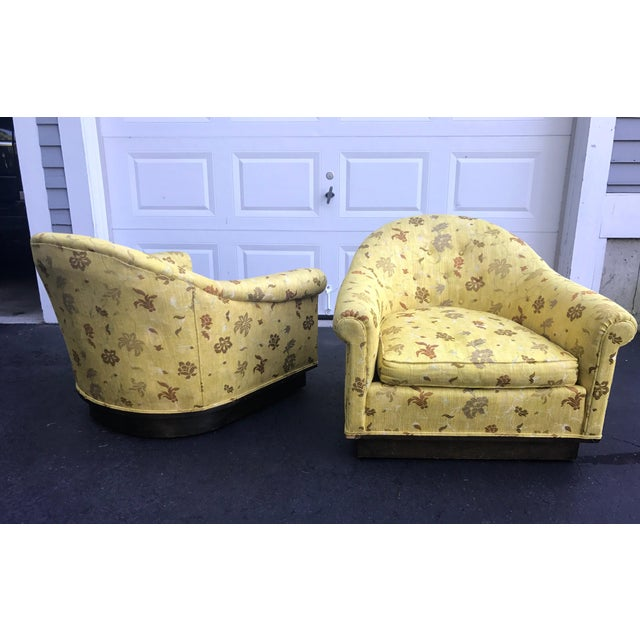 Gorgeous pair of matching Milo Baughman style barrel chairs on casters with newer Scalamandre upholstery which is...