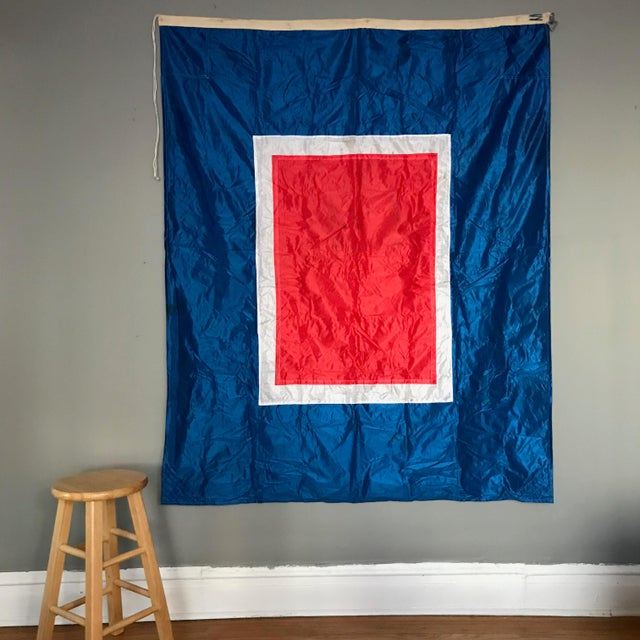 This large vintage nylon flag is in great condition. The red, navy and white colors are bright and the flag has its...