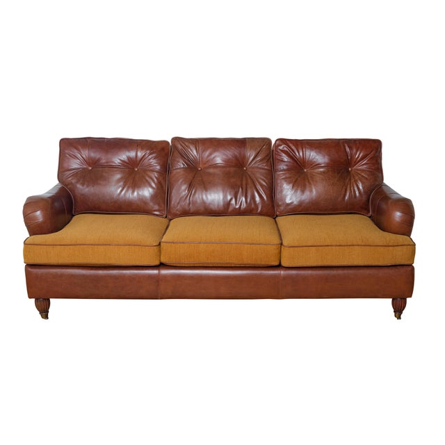 This is a very comfortable English rolled arm sofa. Newly re-upholstered in genuine leather and caramel fabric. The...