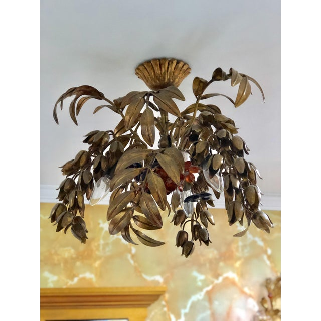 Maison Bragues style flush mount 3 light chandelier. Hand gilded wrought iron in the shape of leaves and stems of flowers....