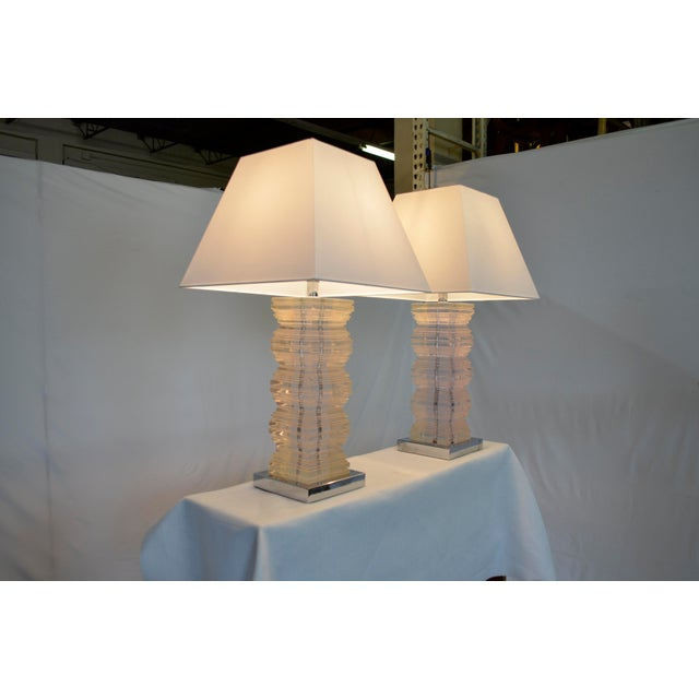 Pair of vintage clear lucite stacked-designed lamps with chrome bases. The lamps have original wiring that's in good...