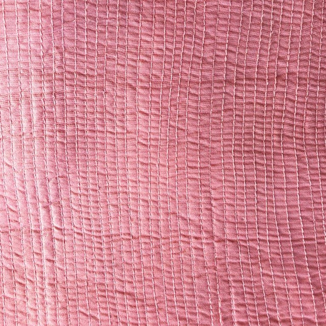 Pair of two vintage pink or coral square Hollywood regency style floor cushions. Each pillow is a box cushion with no...