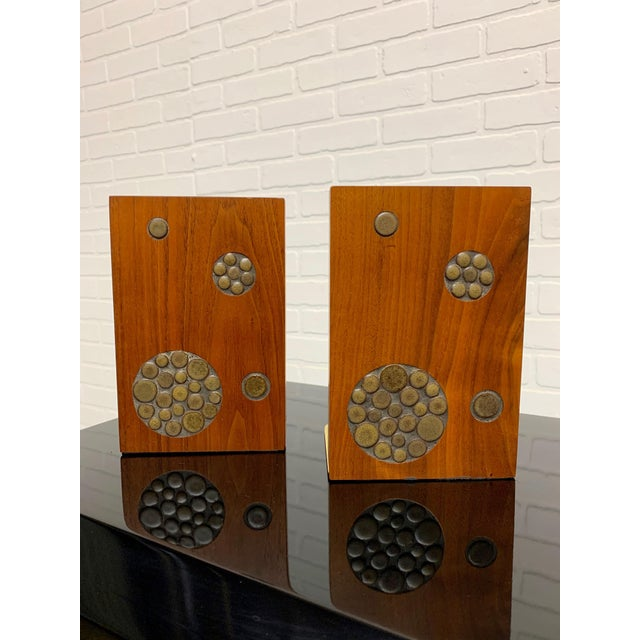 Solid walnut with circular inlaid tiles make for a stunning pair of bookends.