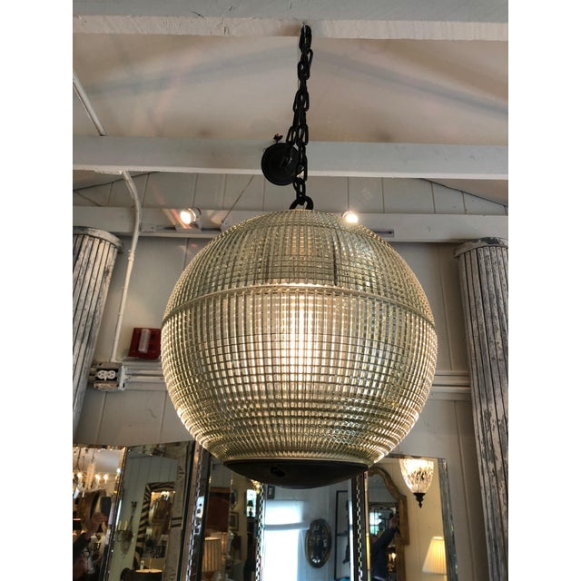 A wonderful very large spherical globe with heavy industrial chain, originally a Paris streetlight and transformed into a...