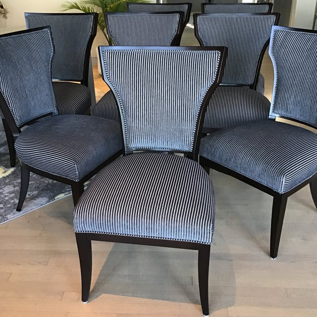 Marvelous set of 8 handcrafted dining chairs by Designmaster Furniture. These chairs feature a timeless klismos design....