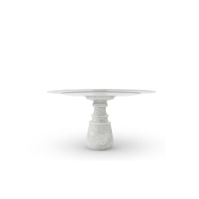 White round table made of white exquisite marble. Its top gently lies in one robust marble pedestal, conceived from a...