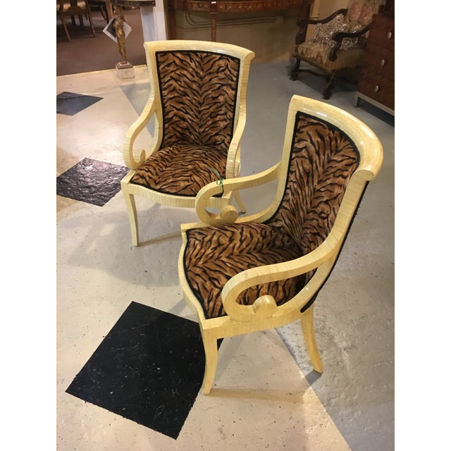 Pair of enrique garcel off-white bone style armchairs, signed. Each tessellated form armchair with scrolling arm and body...