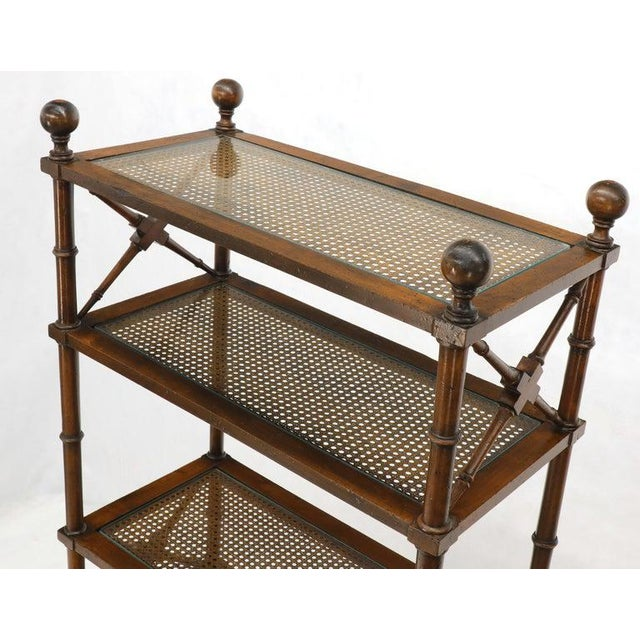 Mid-Century Modern faux bamboo shelving unit vitrine with X stretchers and fine turned wood finials. Unsigned possibly...