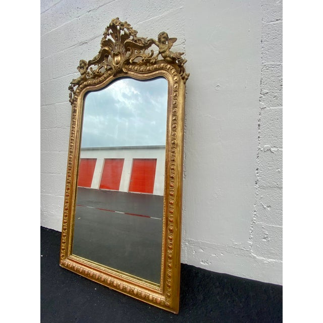 French French Giltwood Carved Flowers and Cherub Louis Style Mirror For Sale - Image 3 of 13